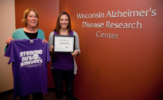 Ali Brems and her mother, Lori Brems, celebrate Ali's gift to the Alzheimer's Disease Research Center that will be used to screen older adults in senior centers who might not have family members who notice when memories are slipping.