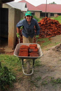 Team leader Aleia McCord moves bricks for the project.