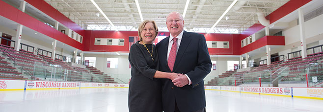 """Former Badger swimmer Charles """"Chuck"""" LaBahn ('49PhB L&S), and his wife, MaryAnn, below, enjoy the LaBahn Arena, which opened in 2012."""