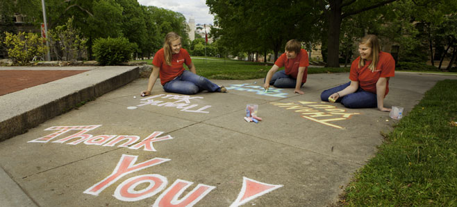 Students chalk a Bascom Hill walkway
